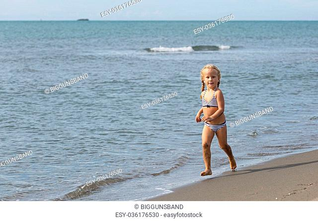 b16c04cc93 Little girl running beach Stock Photos and Images | age fotostock