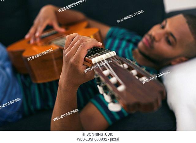 Man playing guitar, close-up
