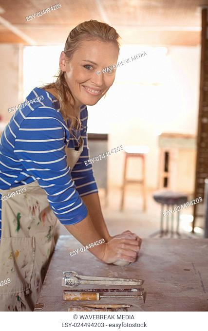 Beautiful woman molding clay Stock Photos and Images   age