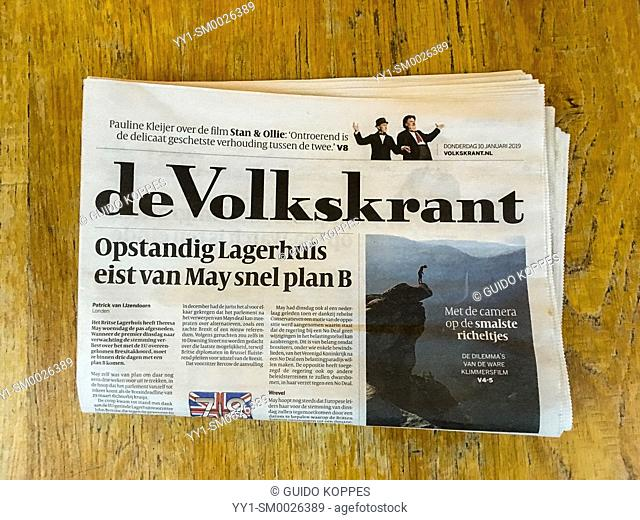 Tilburg, Netherlands. A newspaper's front page on a cafe's table breaking a new story about Brexit. Printed media are in decline all over Europe and are being...