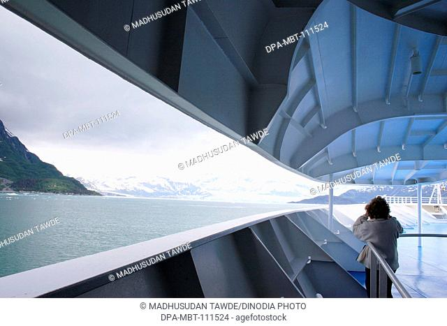 A lady watching from cruise ship a Hubbard glacier; The longest tidewater glacier in Alaska ; Saint Elias  national park ; Disenchantment bay ; Alaska ; U