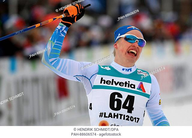 Finnish athlete Iivo Niskanen celebrates after taking gold at the Nordic Ski World Championship in Lahti, Finland, 28 February 2017