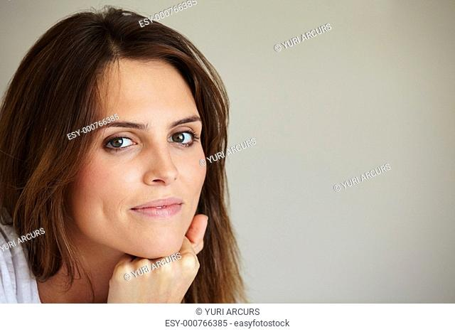 Closeup portrait of lovely young female smilling - Copyspace