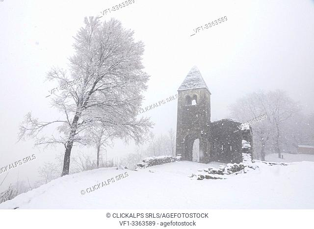 Abbey of San Pietro in Vallate during a snowfall, Piagno, Sondrio province, Valtellina, Lombardy, Italy