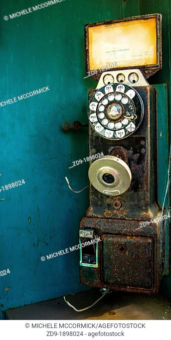 A classic pay phone rusts and deteriorates on a dock in California's Bodega Bay