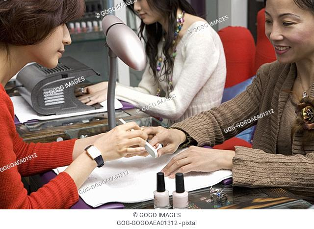 Women getting manicures