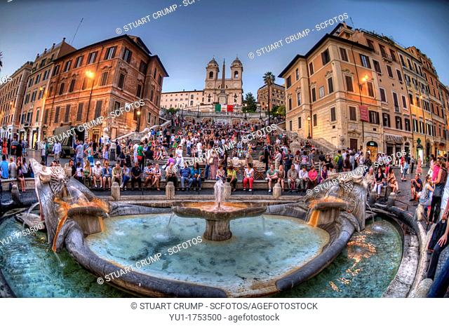 HDR Fisheye view of the The Spanish Steps with the Trinità dei Monti church at the top as seen from the Fontana della Barcaccia in the Piazza di Spagna, Rome