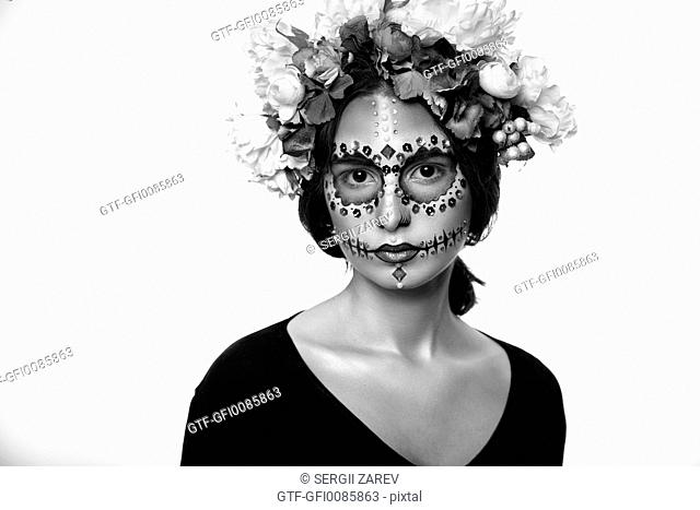 Fashion portrait of a beautiful Halloween model with creative make up isolated o