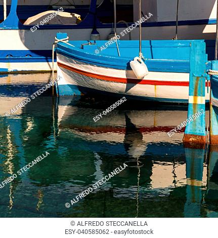 Small traditional fishing boat, made of wood, coloured, painted, Sicily