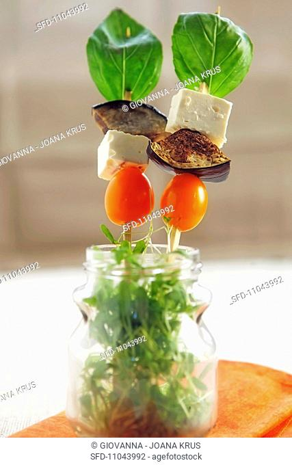 Aubergine and feta kebabs with basil and cress