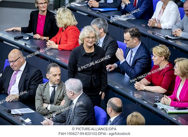 27 June 2019, Berlin: Christine Lambrecht (SPD, M), Federal Minister of Justice, runs through the government bank in the Bundestag before being sworn in as...
