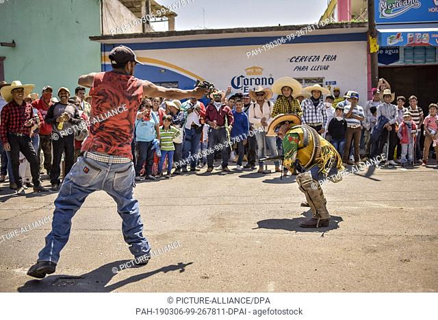 "05 March 2019, Mexico, San Juan de la Vega: Participants of the """"Festival of Explosive Hammers"""" stage a ritual within the framework of the festival"