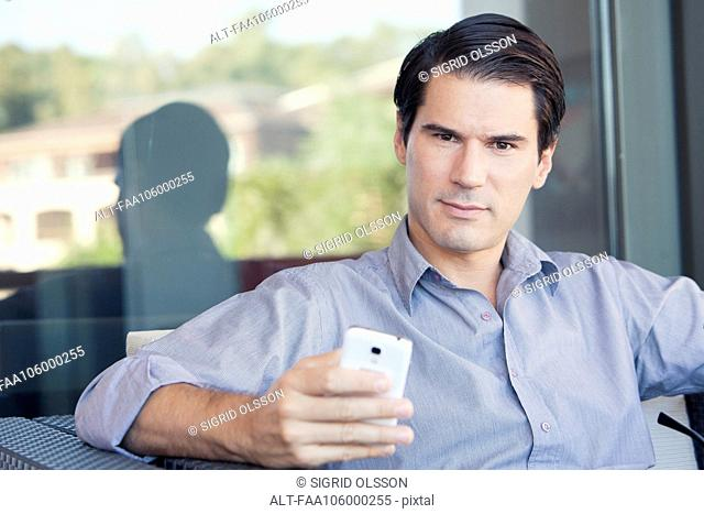 Man using smartphone, portrait