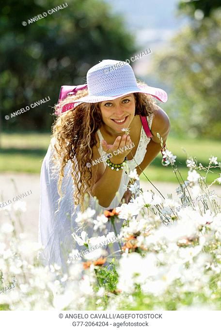 Young caucasian woman 33 years outdoor among flowers