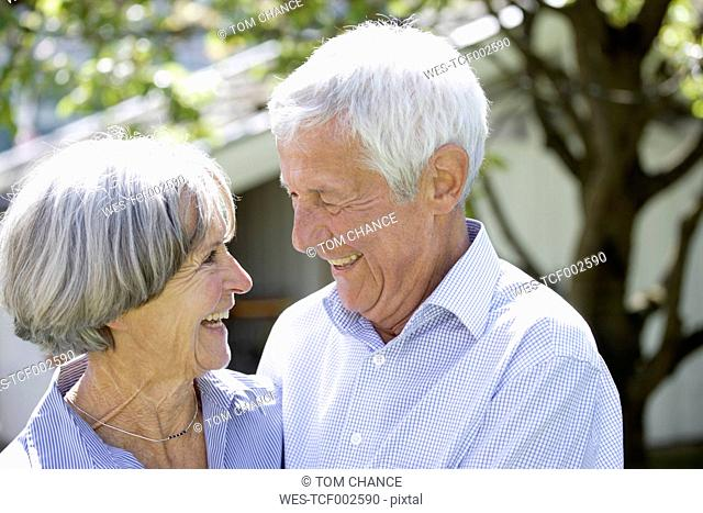 Germany, Bavaria, Senior couple looking at each other, smiling