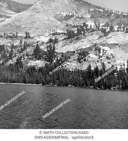 Lake with mountains and trees in Yosemite Park, Yosemite Valley, California, 1958