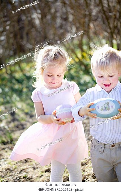 Boy and girl with Easter eggs