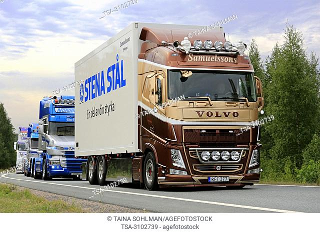 LEMPAALA, FINLAND - AUGUST 9, 2018: Brown Volvo FH truck of Samuelssons Akeri on road in truck convoy to Power Truck Show 2018, Finland