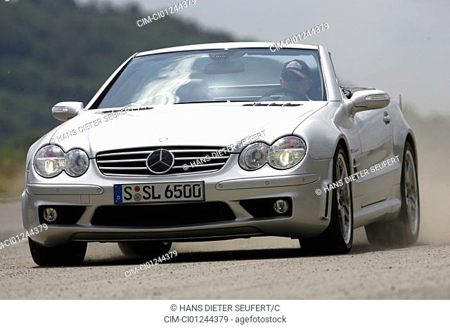 Car, Mercedes SL 65 AMG, Convertible, model year 2004-, silver, Tuning, open top, driving, diagonal from the front, frontal view, test track
