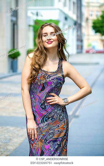 Portrait of beautiful model woman in long color dress