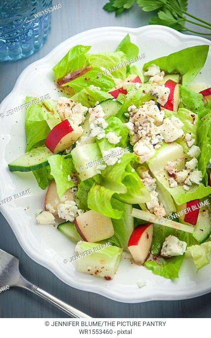 A Salad of Greens, Blue Cheese, Red Pears, Cucumber and Cranberry Vinaigrette