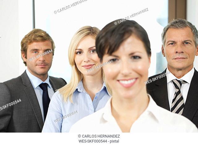 Germany, Frankfurt, Business people in office, smiling, portrait