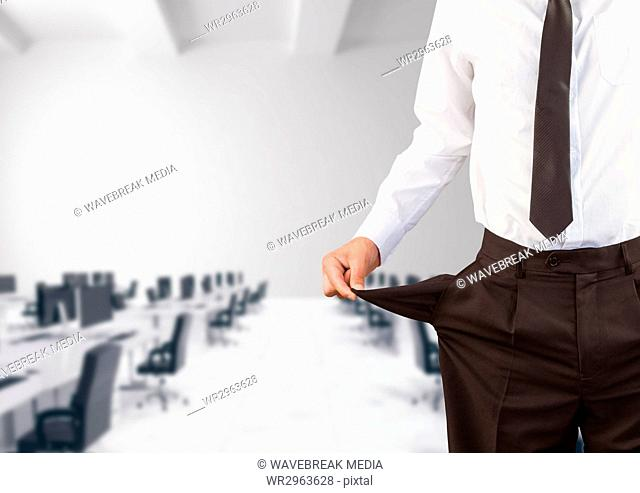 Midsection of businessman showing empty pockets
