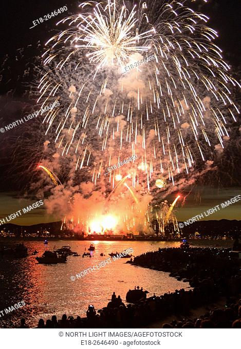 Canada, BC, Vancouver. Fireworks explode in the sky over English Bay during the annual Fireworks Festival