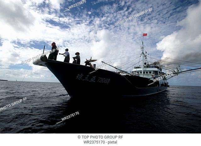 China Hainan Province Sansha City South Sea the Nansha Islands Fiery Cross reef Fishermen fishing 2010