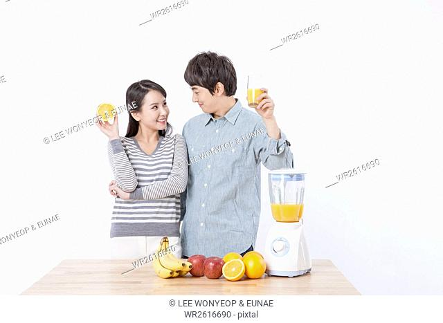 Young smiling couple with homemade juice