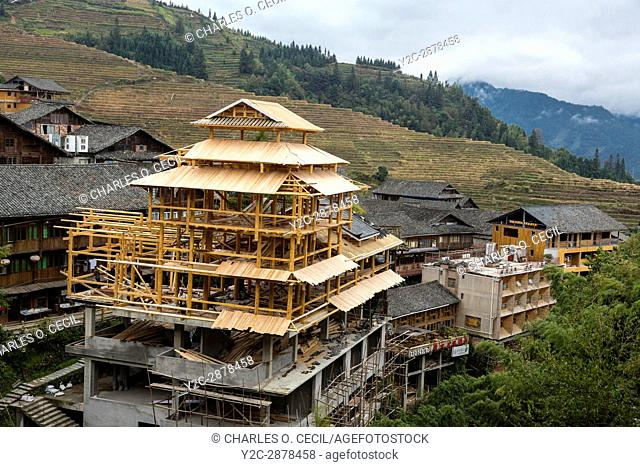 Longji, China. Building Under Construction. Rice Terraces in Background