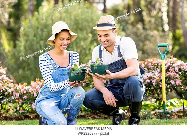 Cute couple doing some gardening activities