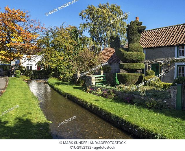 Cottages and Topiary Chicken by the Stream in Bishop Monkton North Yorkshire England