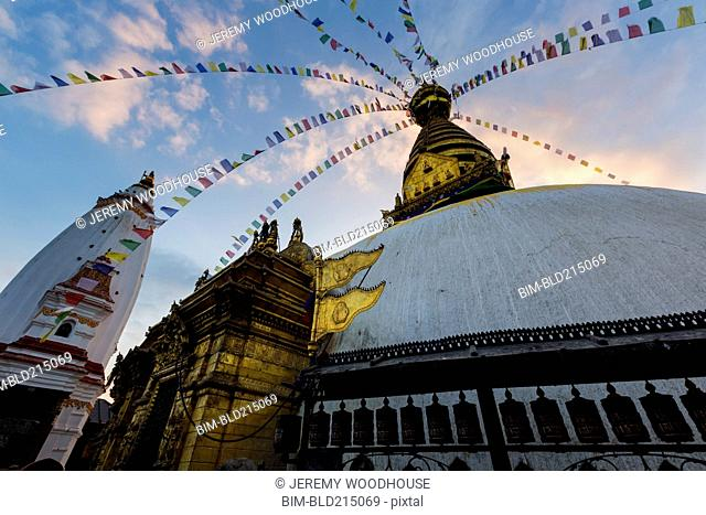 Low angle view of prayer flags hanging from temple, Kathmandu, Kathmandu Valley, Nepal