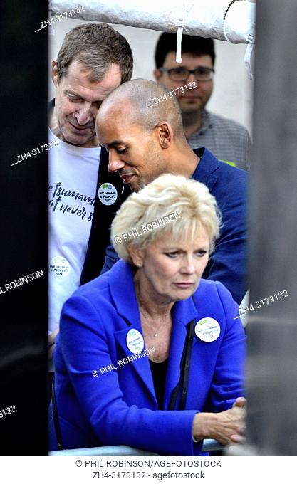 Alastair Campbell talking to Chuka Umunna MP behind Anna Soubry MP (Con: Broxtowe) backstage before speaking at the People's Vote March in support of a second...