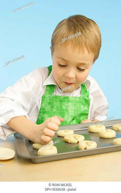 Boy making cookies