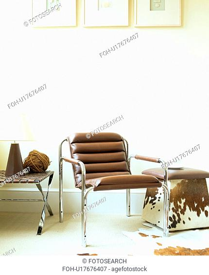 Brown leather and chrome chair in modern white living room