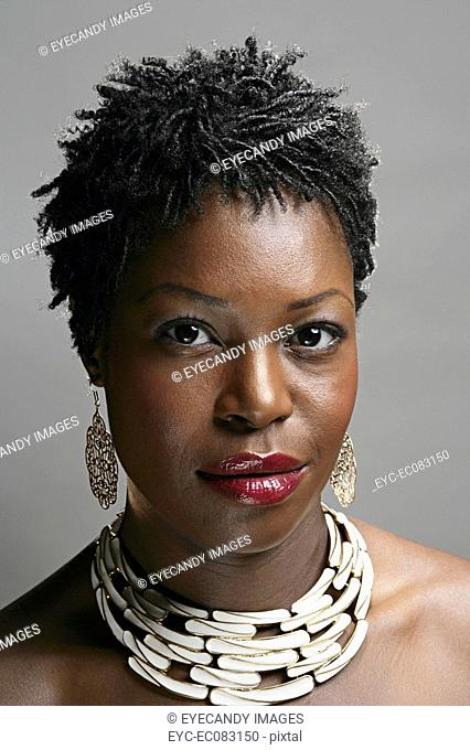 Portrait of serious African American woman, studio shot