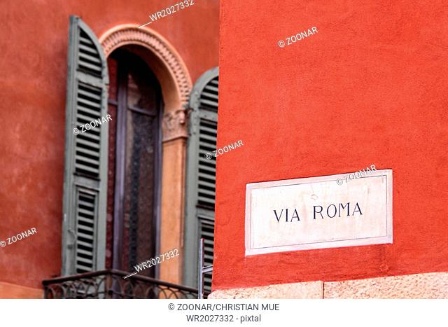 Via Roma street sign in the old town of Verona