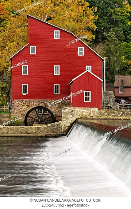 Historic landmark of the Red Mill at Clinton, New Jersey during a Autumn afternoon. The red mill was built in the early 1800's to process wool