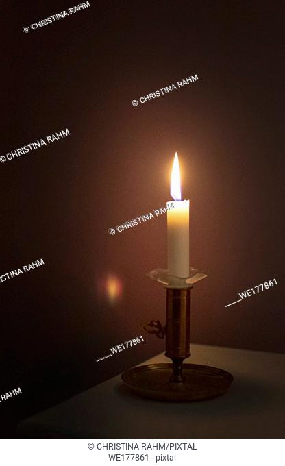 Simple candle burning in darkness, various concepts of darkness to light, prayer symbolism, illumination, awakening and more