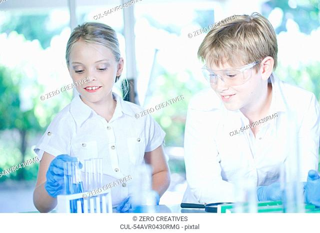 Children playing scientists in lab