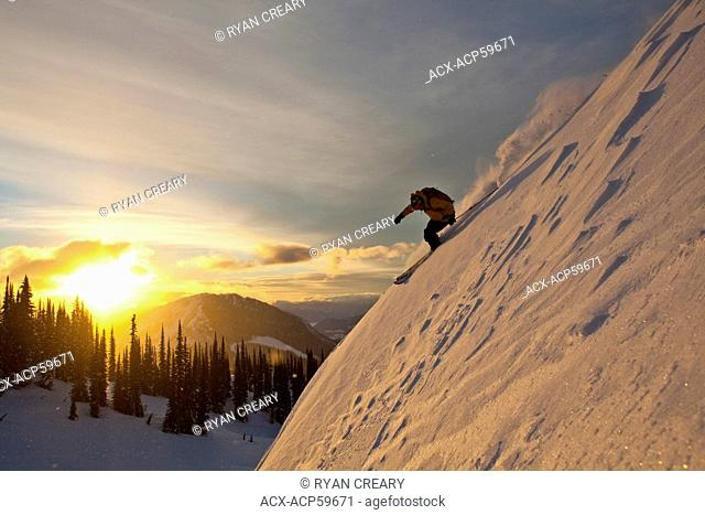A man skiing deep powder while backcountry skiing at Sol Mountain, Monashee Backcountry, Revelstoke, BC