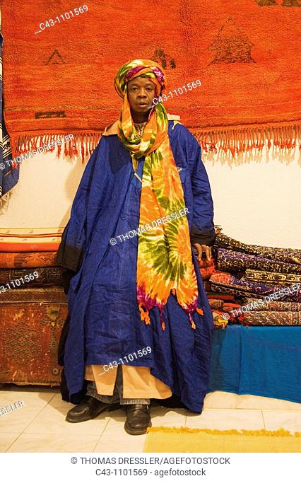 Morocco - Colourful outfit of an employee in a carpet shop in Tafraoute  Ameln valley, Anti-Atlas mountains, Morocco