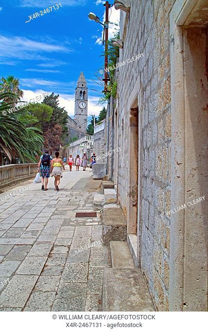 Promenade on Lopud Island, view towards belltower of the Franciscan Friary, Lopud Island, Dubrovinik, Dalmatian Coast, Croatia