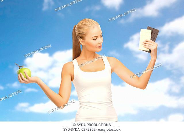 woman choosing between green apple chocolate