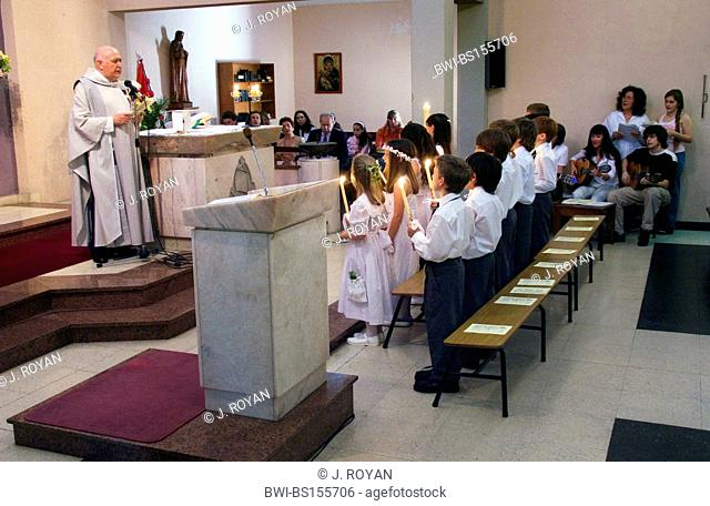 a catholic first comunion in a modern church, Argentina, Buenos Aires