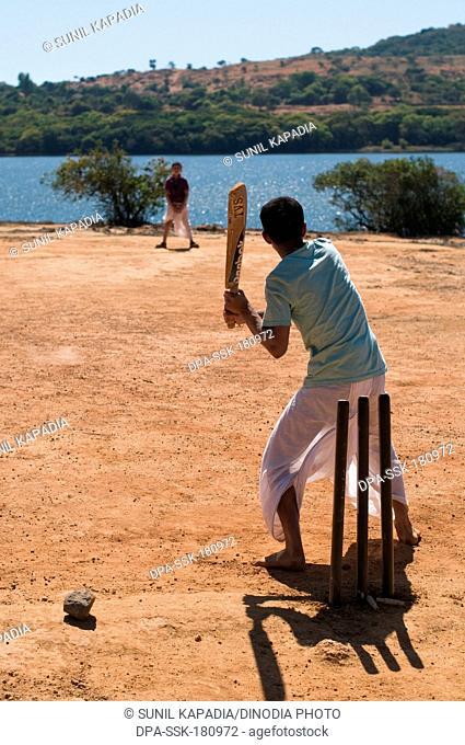 Boys playing cricket Satara Maharashtra India Asia Jan 2012 No MR