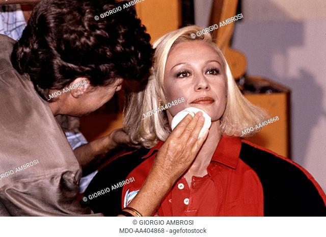 Raffaella Carrà being made up. Italian TV presenter, actress, singer and showgirl Raffella Carrà (Raffaella Maria Roberta Pelloni) making up before the shooting...