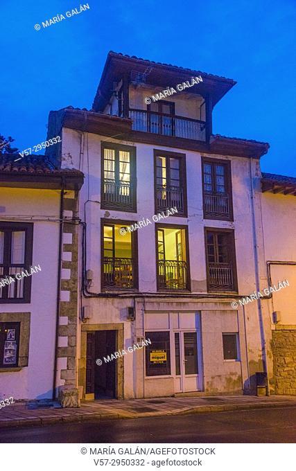 Facade of house, night view. Bustio, Asturias, Spain